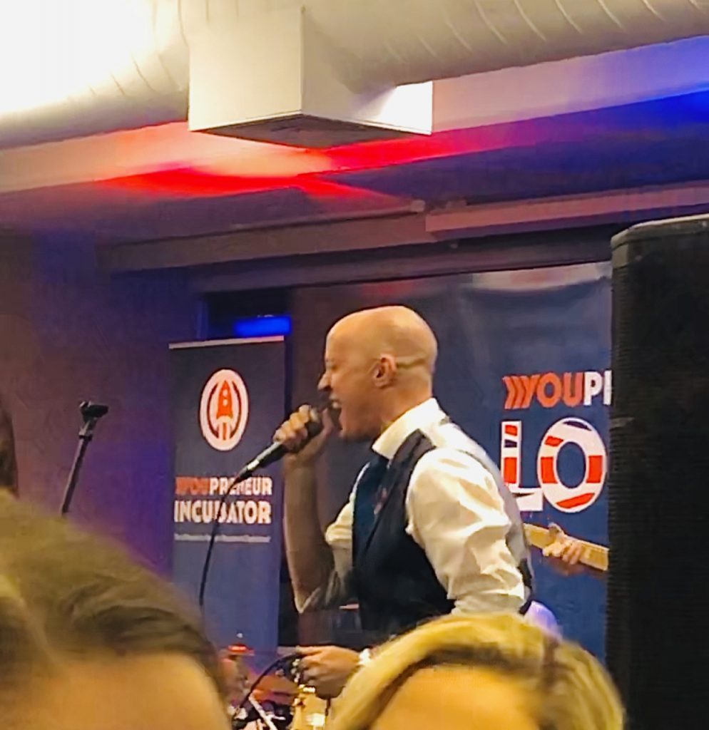 Chris Ducker singing at Youpreneur Summit 2019